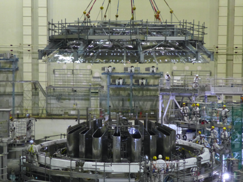 Figure1 Top cryostat thermal shields being installed