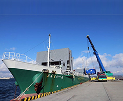 photo of Figure 5. A TFC is being loaded on a transport ship
