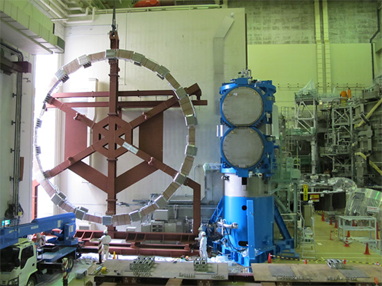 photo of The world´s largest class superconducting coil, EF6 entering the assembly hall